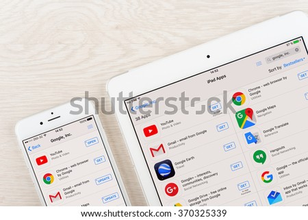 Moscow, Russia - January 30, 2016: Google applications on iphone and ipad display. Google is an American multinational corporation specializing in Internet related services and products. - stock photo