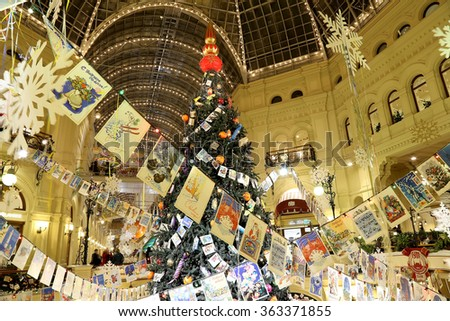 MOSCOW, RUSSIA- JANUARY 14, 2016: Interior Main Universal Store (GUM) in the Christmas (New Year) holidays, Red Square, Moscow, Russia. Inscriptions in Russian GUM and Happy New Year