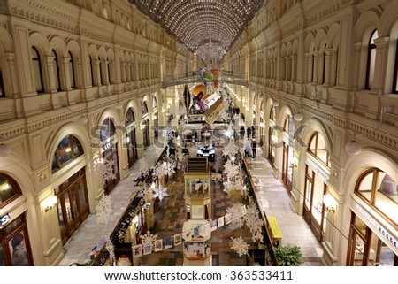 MOSCOW, RUSSIA- JANUARY 14, 2016:Interior Main Universal Store (GUM) in the Christmas (New Year) holidays, Red Square, Moscow, Russia. Inscriptions in Russian Main Universal Store (GUM)  - stock photo