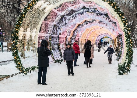 MOSCOW, RUSSIA - January 14, 2015: People and tourists walk along Moscow decorated for New Year and Christmas holidays. Christmas village fair on Tverskaya street in the Moscow - stock photo