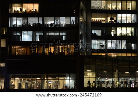 MOSCOW, RUSSIA - JANUARY 16, 2015:  Windows of the offices and the fitness center in the skyscraper in Moscow city district, Moscow, January 16, 2015.  - stock photo