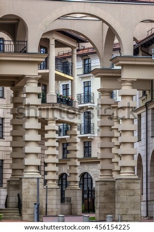 MOSCOW, RUSSIA - JULY 21, 2016. Architectural details - arches, balconies, columns - design of a modern home. Like Escher's illusions. - stock photo