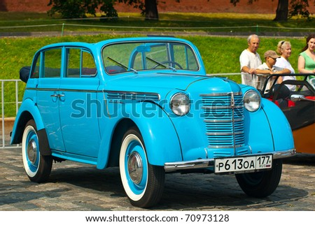 """MOSCOW,RUSSIA-JULY 10: Blue Moskvich (old car USSR) on display at the start annual Rally of classical cars  """"Zolotoe kol'co"""" on Red Square on July 10, 2010 in Moscow, Russia - stock photo"""