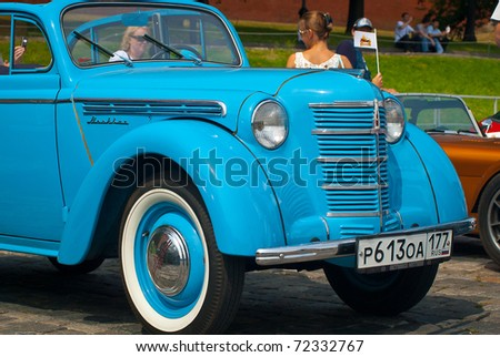 MOSCOW,RUSSIA-JULY 10: Blue Moskvich (vintage car USSR)  is on display at the start annual Rally of classical cars Zolotoe kol'co on Red Square, on July 10, 2010 in Moscow, Russia - stock photo