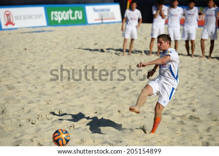 MOSCOW, RUSSIA - JULY 13, 2014: Bogomolov, Kazakhstan performs penalty shoot-out in the match with Estonia during Moscow stage of Euro Beach Soccer League. Kazakhstan won 3:2 after penalty shoot-out - stock photo