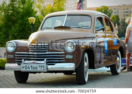 MOSCOW, RUSSIA-JULY 31: Brown GAZ Pobeda (vintage USSR car) on exhibition parking at annual 'Night Moscow Classic Rally'. The sixth race of vintage cars, more than 50 crews, from owners to showstars - stock photo