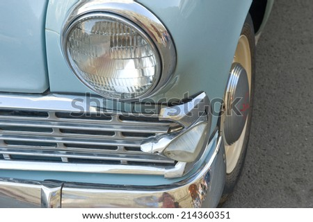 MOSCOW, RUSSIA - July 26, 2014: Car Moskvich-403IE on retro rally Gorkyclassic,  GUM, Moscow, fragment with headlight
