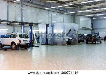 MOSCOW, RUSSIA - JULY 01, 2015: Cars for repair service station. Auto Service is the official dealer of Auto VAZ