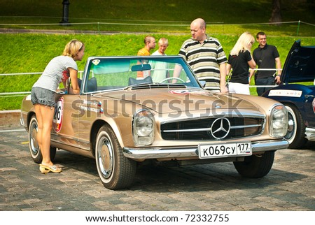 MOSCOW,RUSSIA-JULY 10: Classic bronze SL Mercedes is on display at the start annual Rally of classical cars Zolotoe kol'co on Red Square, on July 10, 2010 in Moscow, Russia - stock photo