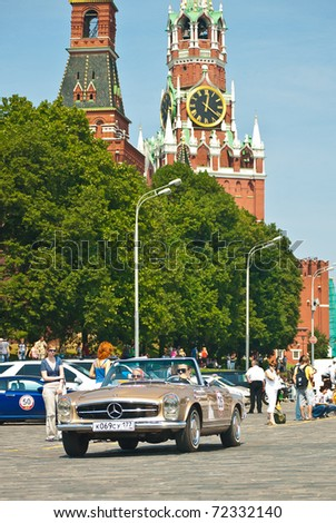 MOSCOW,RUSSIA-JULY 10: Classic bronze SL Mercedes is on start at the start annual Rally of classical cars Zolotoe kol'co on Red Square, on July 10, 2010 in Moscow, Russia - stock photo