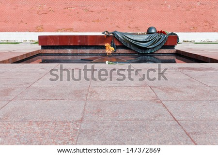 MOSCOW, RUSSIA - JULY 12: eternal flame at Tomb of the Unknown Soldier in Moscow, Russia on July 12, 2013. It is war memorial near Kremlin Wall, dedicated to Soviet soldiers killed during World War II - stock photo
