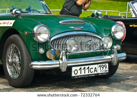 MOSCOW,RUSSIA-JULY 10: Green Austin Healey 3000 Mk II (1962) is on display at the start annual Rally of classical cars Zolotoe kol'co on Red Square, on July 10, 2010 in Moscow, Russia - stock photo