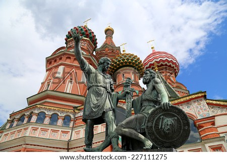 MOSCOW, RUSSIA- JULY 08, 2014: Moscow, Russia, Red Square, Cathedral of Intercession of Most Holy Theotokos on the Moat ( Temple of Basil the Blessed),   Minin and Pojarsky monument (1818)