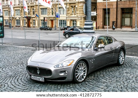 MOSCOW, RUSSIA - JULY 10, 2011: Motor car Maserati GranTurismo in the city street. - stock photo