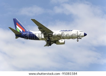 MOSCOW, RUSSIA - JULY 01: Plane Boeing 737 of Malev Hungarian Airlines landing in Moscow airport July,1 2011.Malev ceased all flight activity on 3 February 2012, after 66 years of continuous operation