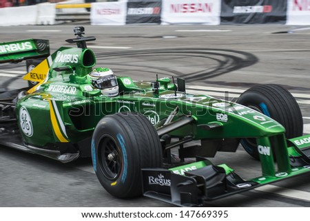 MOSCOW, RUSSIA - JULY 21: Professional Formula 1 Caterham F1 driver Heikki Kovalainen in Moscow City Racing Circle, Moscow on 21 July 2013, Russia - stock photo