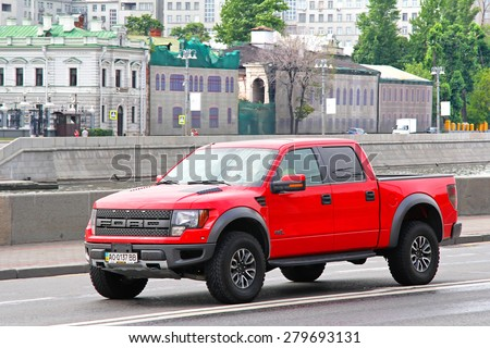 MOSCOW, RUSSIA - JULY 7, 2012: Red pickup truck Ford F-150 Raptor at the city street. - stock photo