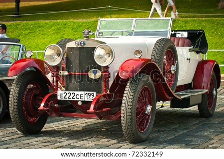 MOSCOW,RUSSIA-JULY 10: Red-Withe alfa romeo 24HP is on display at the start annual Rally of classical cars Zolotoe kol'co on Red Square, on July 10, 2010 in Moscow, Russia - stock photo