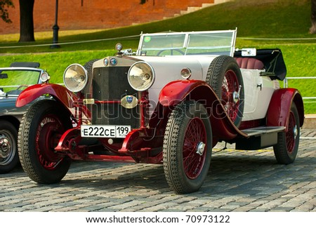 """MOSCOW,RUSSIA-JULY 10: Red-Withe alfa romeo 24HP on display at the start annual Rally of classical cars  """"Zolotoe kol'co"""" on Red Square on July 10, 2010 in Moscow, Russia - stock photo"""