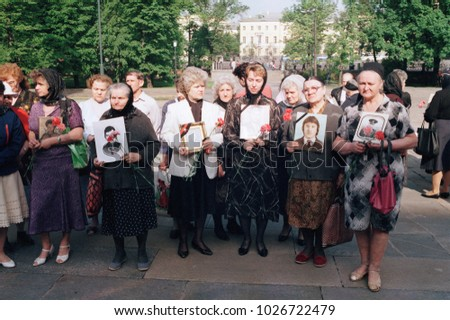 Moscow, Russia - July 10, 1992: Remembrance day of dead russian soldiers organised by Committee of Soldiers' Mothers of Russia. Mothers holding portraits of their perished sons.