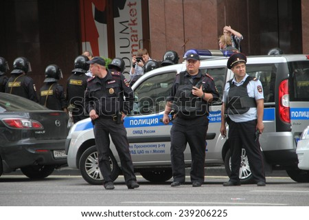 Moscow, Russia - July 18, 2013. Russian police during the opposition rally. Thousands of Muscovites went on this day in support of arrested opposition leader Alexei Navalny - stock photo