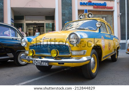MOSCOW, RUSSIA - July 26, 2014:  Soviet police retro car Volga GAZ-21 retro rally Gorkyclassic about Gum, front view