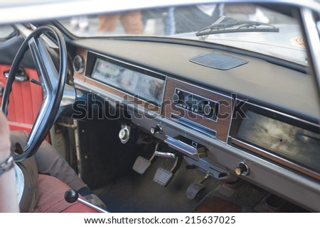 """MOSCOW, RUSSIA - July 26, 2014:  Soviet retro GAZ-24 """"Volga"""" retro rally Gorkyclassic in the Parking lot near Gum Department store, Moscow, cabin - stock photo"""