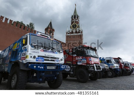 MOSCOW, RUSSIA - JULY 7, 2016: Sports cars and trucks awaiting the start of the Silk way rally Moscow-Beijing Dakar series on the Red Square near the Kremlin