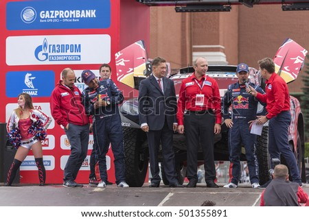 MOSCOW, RUSSIA - JULY 7, 2016: The head of Gazprom Alexei Miller opens Silk Way rally Dakar series on the Red square near the Kremlin