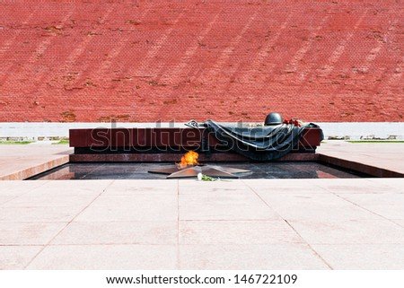 MOSCOW, RUSSIA - JULY 12: Tomb of the Unknown Soldier in Moscow, Russia on July 12, 2013. It is war memorial near Kremlin Wall, dedicated to the Soviet soldiers killed during World War II - stock photo