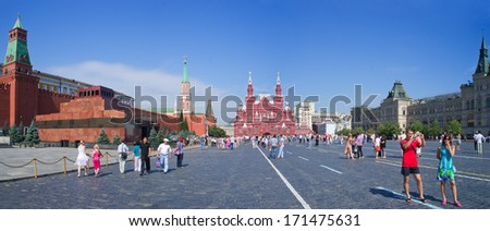 MOSCOW, RUSSIA - JULY, 24, 2011: Tourists walking on Red square near Kremlin wall and Historical Museum in Moscow, Russia. Red Square is central place and popular site in Moscow.