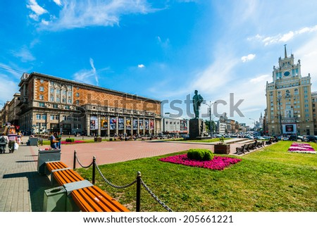 MOSCOW, RUSSIA - JULY 15, 2014: Triumph Square of Moscow. Tchaikovsky concert hall (left), The Satire Theatre (behind the hall), monument to the Soviet poet Mayakovsky (center), hotel Beijing (right) - stock photo