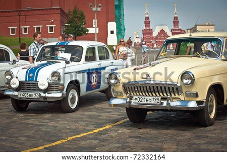 MOSCOW,RUSSIA-JULY 10: Two GAZ Volga (vintage car USSR)  is on display at the start annual Rally of classical cars Zolotoe kol'co on Red Square, on July 10, 2010 in Moscow, Russia - stock photo