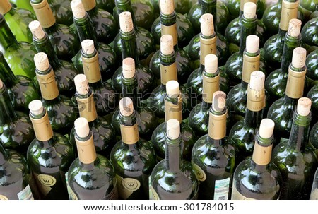 MOSCOW, RUSSIA - JULY, 23 2015: very much stacked up wine bottles  with  corks