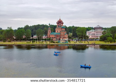 Moscow, Russia - July 3, 2010: View onto Holy Trinity Church through Ostankino pond with boats - stock photo