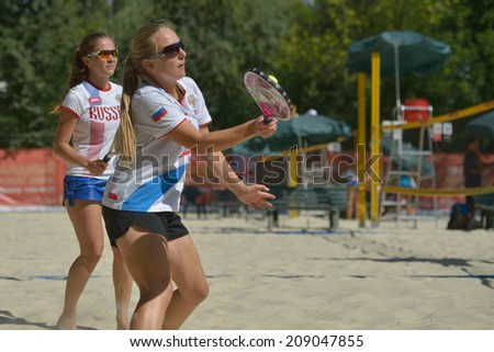 MOSCOW, RUSSIA - JULY 19, 2014: Women's double of Russia in the match against Italy during ITF Beach Tennis World Team Championship. Italy won in two sets - stock photo