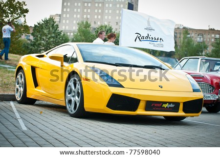 MOSCOW, RUSSIA-JULY 31: Yellow Lamborghini on exhibition parking at an annual event, the VI race of vintage cars 'Night Moscow Classic Rally' on July 31, 2010 in Moscow, Russia - stock photo