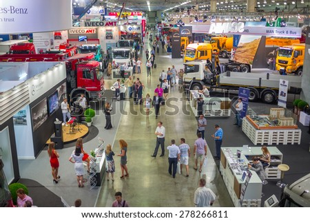 MOSCOW, RUSSIA - JUN 06, 2014: big auto trade show commercial vehicle manufacturers of famous brands on International Specialized Exhibition of Construction Equipment and Technologies  - stock photo
