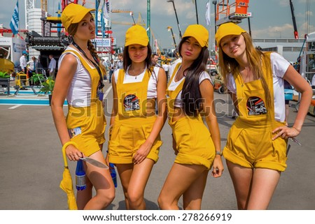 MOSCOW, RUSSIA - JUN 06, 2014: Four girls posing promoter on International Specialized Exhibition of Construction Equipment and Technologies - stock photo
