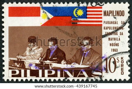 MOSCOW, RUSSIA - JUNE 05, 2016: A stamp printed in Philippines shows Presidents Sukarno and Macapagal and Prime Minister Tunku Abdul Rahman, Signing of the Manila Accord (Mapilindo) by Malaya, 1965 - stock photo