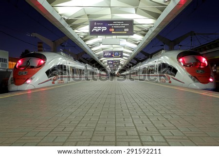 "MOSCOW, RUSSIA - JUNE, 05 2015: Aeroexpress Train Sapsan at the Leningrad station (night). Moscow, Russia -high-speed train acquired OAO ""Russian Railways"" for use on the Russian high-speed railways - - stock photo"