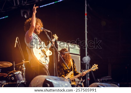MOSCOW, RUSSIA - JUNE 29, 2014 - Australian hard rock band Wolfmother performing live at Park Live festival at at the National Exhibition Centre on June 29, 2014 in Moscow, Russia - stock photo