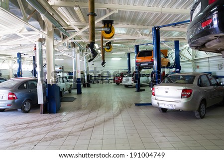 MOSCOW. RUSSIA - JUNE 12, 2013: Cars for repair service station. Auto Service is the official dealer of Auto VAZ