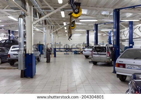 MOSCOW. RUSSIA - JUNE 11, 2014: Cars for repair service station. Auto Service is the official dealer of Auto VAZ - stock photo
