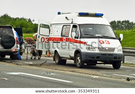 MOSCOW, RUSSIA - JUNE 7, 2012: Emergency team working in road with car accident - stock photo