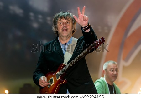 "MOSCOW, Russia – June 04: Emir Kusturica plays guitar with the musicians on the football musical festival ""Art-football 2017""at the Lokomotiv stadium. 04 June 2017 in Moscow, Russia."