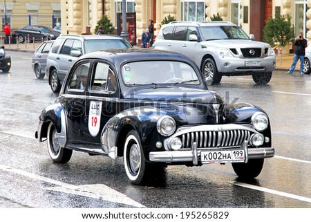 MOSCOW, RUSSIA - JUNE 3, 2012: French motor car Peugeot 203 competes at the annual L.U.C. Chopard Classic Weekend Rally. - stock photo