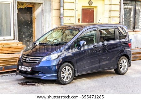 MOSCOW, RUSSIA - JUNE 2, 2013: Motor car Honda Freed at the city street. - stock photo