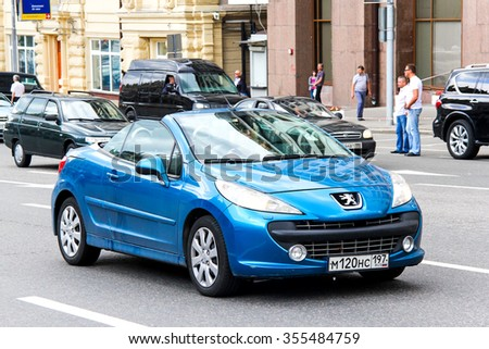 MOSCOW, RUSSIA - JUNE 2, 2013: Motor car Peugeot 207CC in the city street. - stock photo
