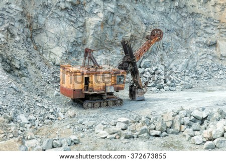 Moscow, Russia - June 01, 2015: Old rusty mine excavator in a stone quarry - stock photo
